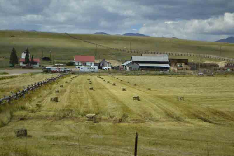 Hay bundles illustrate a working mountain farm.