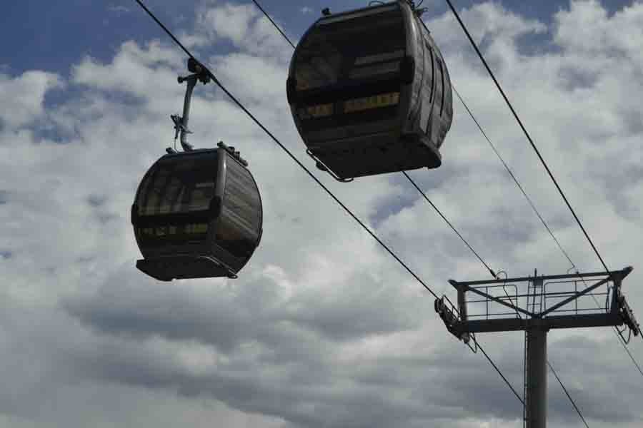 Cable cars in Breckenridge pass overhead Highway 9.