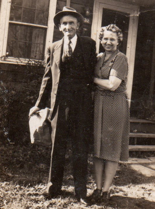 A young Mason and Grace Johnston pose in front of their Alexander Park home.
