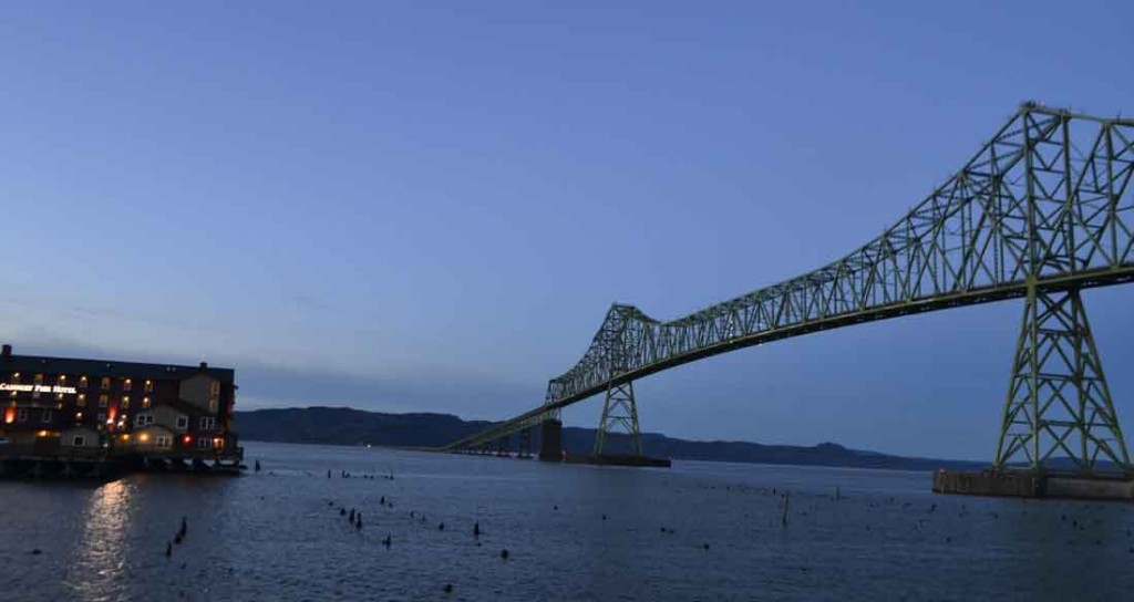 The Cannery Pier Hotel is a perfect nighttime juxtaposition to Astoria's Columbia River bridge.