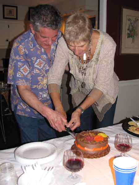 The committed couple cut a creative ceremonial cake.