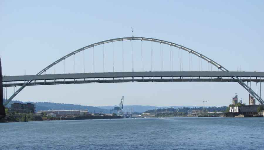 The Fremont Bridge (1973) carries Interstate 405 and US 30 above.