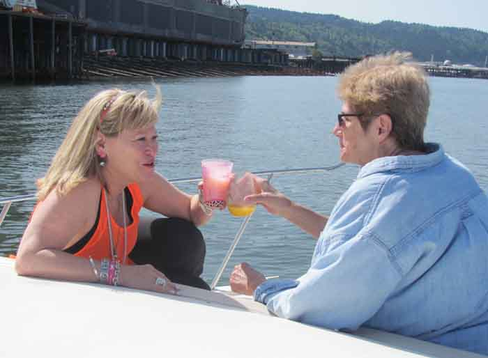 Pauletta and Alice salute a delightful day on the Willamette.