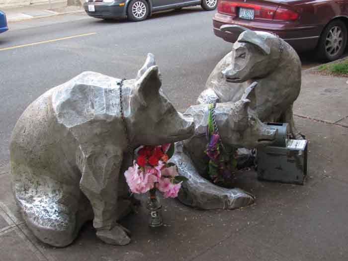 The cast-iron sculptures next to the Nob Hill Bar & Grill undergo occasional changes by creator Joe Justice.  For example, they wore lipstick when Sarah Palin ran for Vice President.