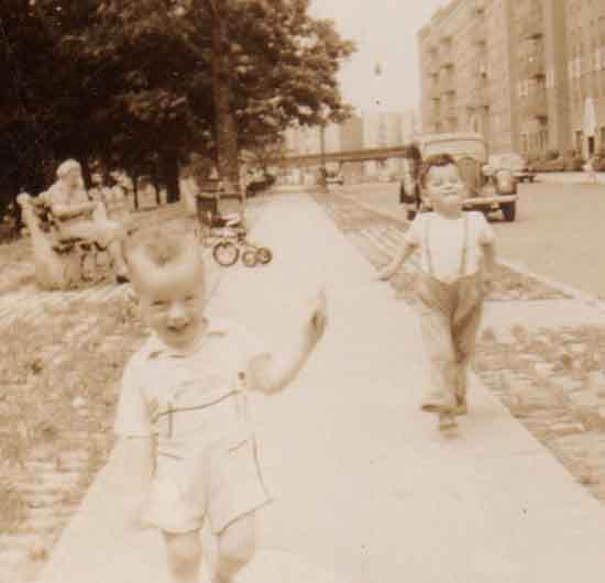 Jonathon runs merrily down the Bronx sidewalk in front of his apartment building while Mason struts proudly behind.