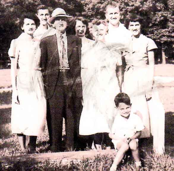 (l-r, top) Gladys, Richard, Mason (grandpa), Grace Wiley, Bill, and Thelma Johnston. (sitting on log) gramdson Mason Loika.
