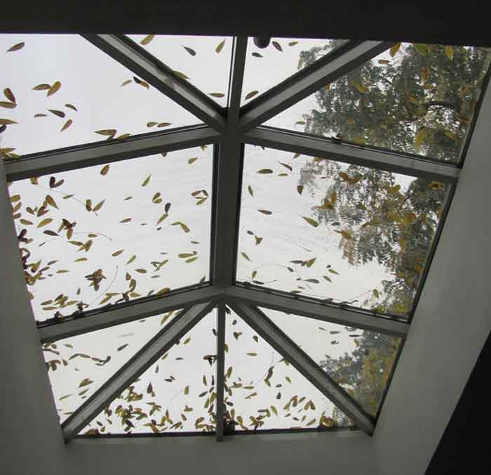 Fallen leaves on the Multnomah Friends' Meetinghouse skylight remind Quakers about changing of the seasons.