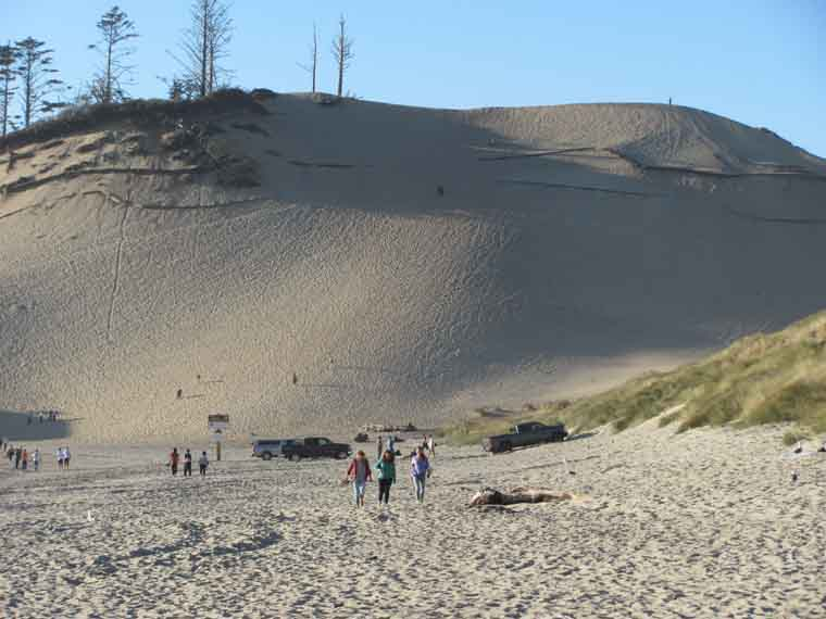 A six-story sand dune offers a picturesque view of Cape Kiwanda's surrounding area.