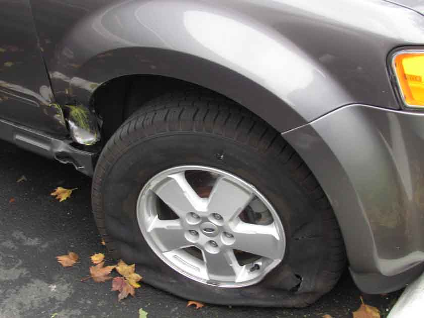 Alice had an encounter with a two-foot-high yellow pole while swerving to avoid being struck by a tractor-trailer.
